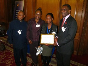 ACD 2013 top GCSE award winner, Janet Osunsami, poses with her parents and Lord Morris